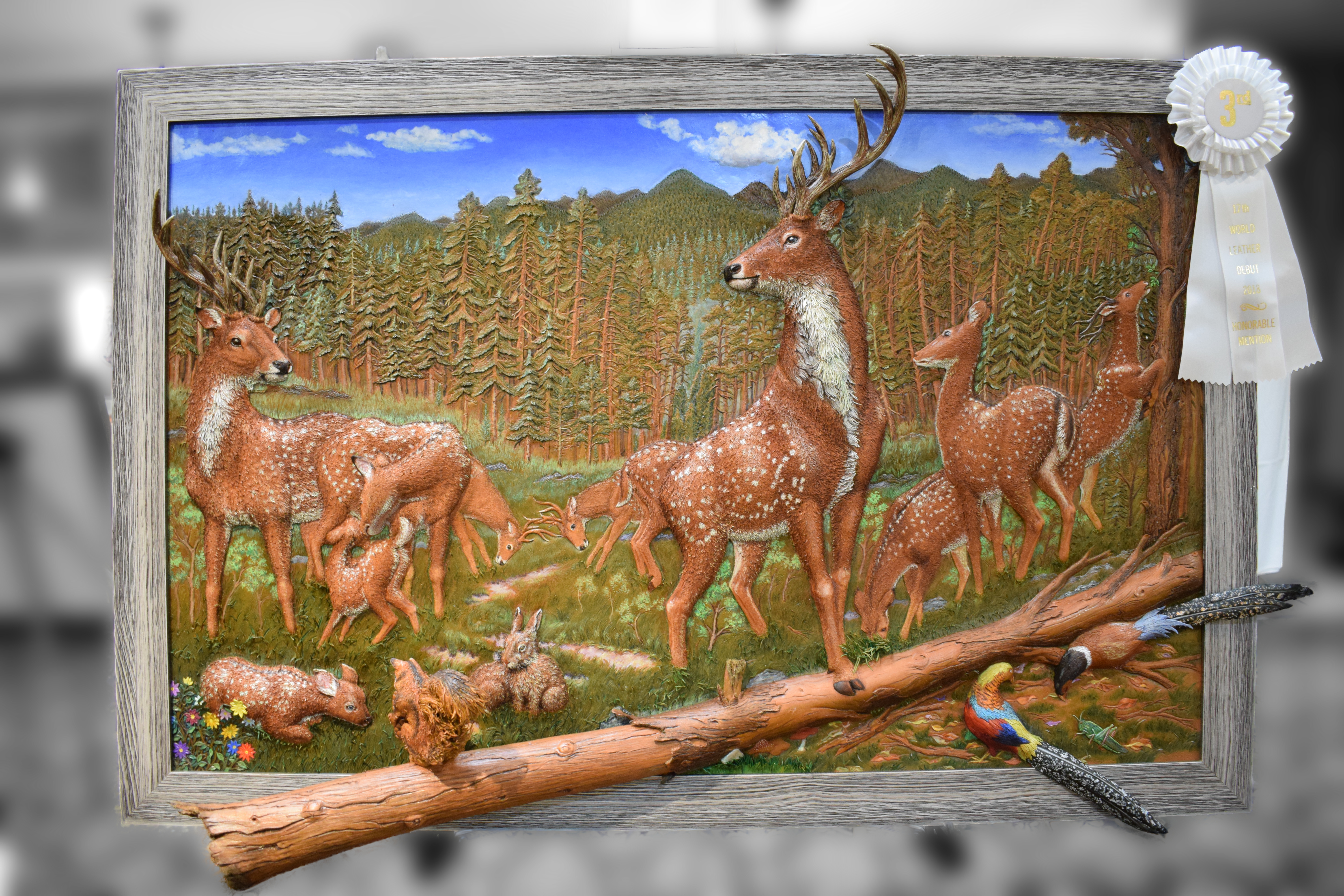 deer in a forest, leather art